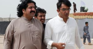 Ali Wazir (left) and Mohsin Dawar, leaders of the Pashtun Tahaffuz Movement (PTM)  at a rally against what they say, are human rights violations by security forces in  Pakistan. Photograph: Reuters/Akhtar Soomro/File Photo