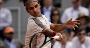 Switzerland's Roger Federer plays a forehand return to Germany's Oscar Otte during their men's singles second round match on day four of The Roland Garros 2019 French Open. Photograph: Getty Images