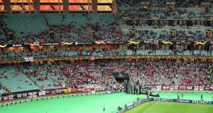 Arsenal fans in the stands with empty seats during the Uefa Europa League final at the Olympic Stadium, Baku, Azerbaijan. Photo: Steven Paston/PA Wire