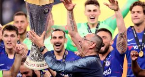 Maurizio Sarri celebrates with the trophy after Chelsea's Europa League final win over Arsenal. Photograph: Adam Davy/PA