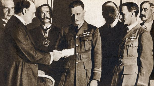 Alcock and Brown are presented with £10,000 prize by Winston Churchill. Photograph: Photo12/UIG/Getty Images