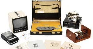 An Apple-1 computer, which cost $666.66 in 1976, sold online through Christie's for £371,250