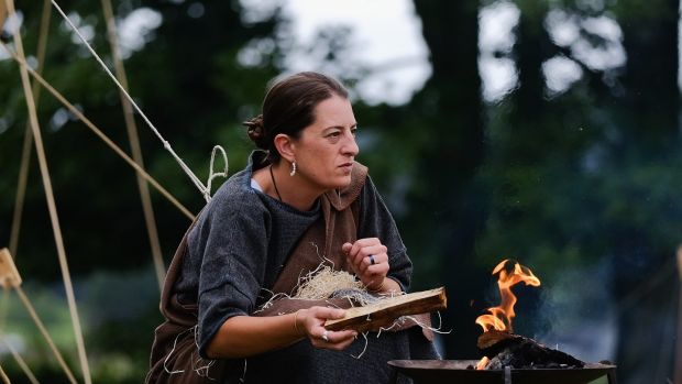 A woman lights a fire outside her tent as the lives of Roman Legionnaires are re-enacted during the Hadrian's Wall Live in Carlisle, England. File photograph: Ian Forsyth/Getty Images