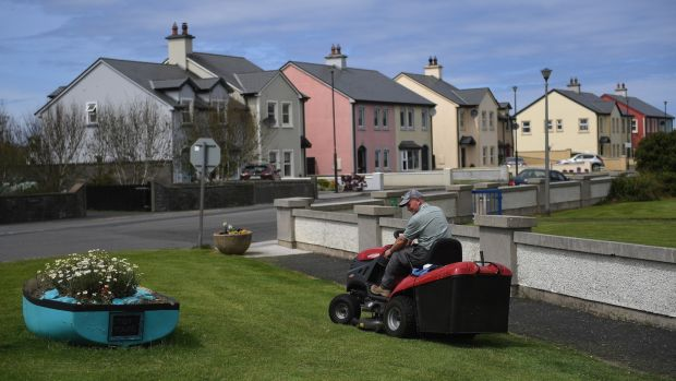 A local man mows the grass to tidy up Doonbeg village ahead of a visit by US President Donald Trump to his nearby golf course in the County Clare village of Doonbeg, Ireland. Photograph: Clodagh Kilcoyne/Reuters