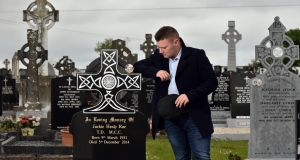Jackie Healy-Rae jnr takes a break from canvassing to visit his grandfather Jackie's grave in Kilgarvan, Co Kerry. Photograph: Don MacMonagle