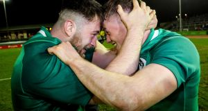 Ireland's Dylan Tierney-Martin and Colm Reilly celebrate the Grand Slam-clinching victory over  Wales in Colwyn Bay, Wales. Photograph: Ryan Byrne/Inpho
