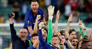 Chelsea's Eden Hazard  and his team-mates celebrate with manager Maurizio Sarri after winning the Europa League in Baku. Photographs: Maxim Shemetov/Reuters
