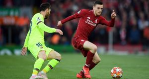 Liverpool's Andy Robertson  takes on Lionel Messi of Barcelona during their epic Champions League semi-final at Anfield. Photograph: Shaun Botterill/Getty Images