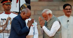 India's president Ram Nath Kovind (left)  administered the oath of office to  Narendra Modi   at a grand ceremony at the presidential palace in New Delhi. Photograph: Reuters/Adnan Abidi