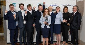 From left: Liam Redmond, country manager of Enactus Ireland; Enactus Trinity College students Rudy O'Leary, Charlie Quirke, Daire Hennessy, Erin Kehoe, Scott Byrne, Aimee Louise Carton; Sene Naoupu Leinster Rugby star and Bank of Ireland ambassador and Terence O'Rourke, chairman of Enactus Ireland at the final in Chartered Accountants House in Dublin. Photograph: Naoise Culhane