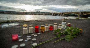 Flowers and candles are placed on the riverbank to pay tribute to the victims of the capsized boat near Margaret Bridge  in Budapest, Hungary. Photograph:  Zoltan Balogh/EPA/Hungary OUT