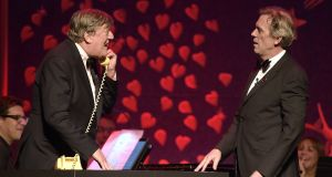 Stephen Fry (L) and Hugh Laurie reunite for a  performance on stage at the SeriousFun London Gala in 2018. Photograph: Mike Marsland/Getty Images)