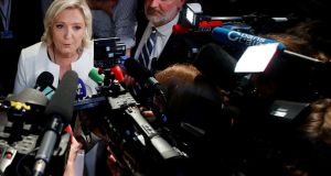 French far-right National Rally (Rassemblement National) party leader Marine Le Pen: has ditched the idea of scrapping the euro and exiting the EU. Photograph: Charles Platiau/Reuters