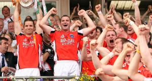 Armagh's Paul McGrane lifts the trophy after victory over Fermanagh in the Ulster football final replay in 2008. Photograph: Cathal Noonan/Inpho