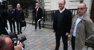 Journalists Trevor Birney (left) Barry McCaffrey outside the Royal Courts of Justice in Belfast. Photograph: Brian Lawless/PA Wire
