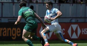Argentina's Franco Sabato runs away from  Ireland's Jack Daly during  their match in the  HSBC Paris Sevens Series at the Stade Jean Bouin in Paris. Photograph:   Lucas Barioulet/AFP/Getty Images