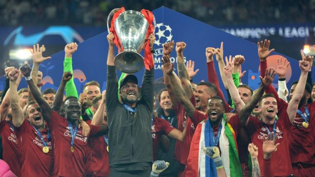 Liverpool manager Jürgen Klopp lifts the trophy after winning the Champions League final against Tottenham Hotspur at the Wanda Metropolitano stadium in Madrid. Photograph: Peter Powell/EPA