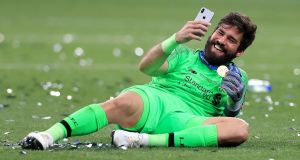 Liverpool goalkeeper Alisson Becker takes a selfie after the victory over Tottenham Hotspur in the Champions League final at the  Wanda Metropolitano in Madrid. Photograph: Mike Egerton/PA Wire