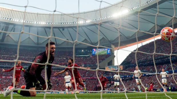 Liverpool's Mohamed Salah celebrates scoring from the penalty spot past Tottenham Hotspur goalkeeper Hugo Lloris during the Champions League final at the Wanda Metropolitano Stadium in Madrid. Photograph: Gabriel Bouys/AFP/Getty Images