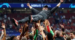 Liverpool manager Jürgen Klopp is thrown in the air by the players as they celebrate the Champions League final win over Tottenham Hotspur. Photograph: Kai Pfaffenbach/Reuters