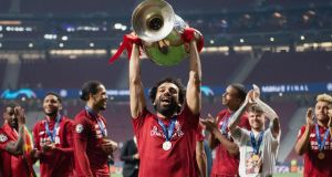Mohamed Salah  lifts the Champions League trophy after Liverpool's victory over Tottenham Hotspur in Madrid. Photograph:  Matthias Hangst/Getty Images