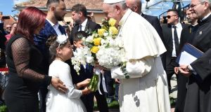 Pope Francis meets members of the Roma community in the Barbu Lautaru district of Blaj, Romania, on Sunday. The pope  is on a three-day visit to Romania.  Photograph: Andreas Solaro/EPA