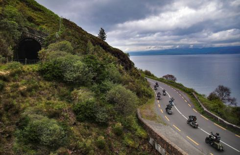 Motorcycle enthuasists on the Iveragh Peninsula, Ring of Kerry route, with the old railway tunnels above. Photograph: Valerie O'Sullivan
