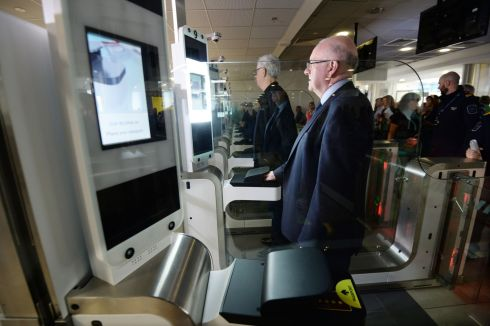 Minister for Justice Charlie Flanagan passes through  the new eGates for passport control in Terminal 1 of Dublin Airport on  Saturday. Photograph: Alan Betson