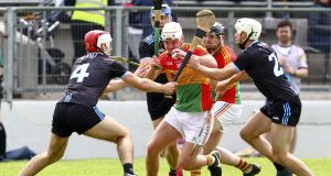 Carlow's Séamus Murphy is tackled by Dublin's Paddy Smyth and Darragh O'Connell  during the Leinster SHC round-robin game at  Netwatch Cullen Park. Photograph:  Ken Sutton/Inpho