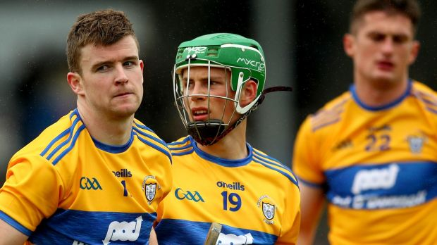 Clare's Tony Kelly, Gary Cooney and Conor Cleary dejected after the game. Photograph: James Crombie/Inpho