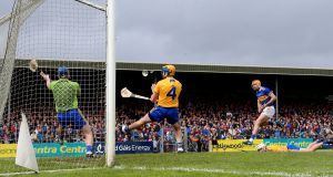 Tipperary's Séamus Callanan scores his side's second goal past Clare goalkeeper  Donal Tuohy during the Munster SHC round-robin game at Cusack Park in Ennis. Photograph: James Crombie/Inpho