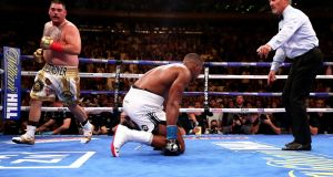 Anthony Joshua is knocked down by  Andy Ruiz jnr  in their  heavyweight  title fight at Madison Square Garden, New York. Photograph:   Nick Potts/PA Wire