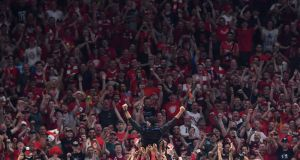 Liverpool players throw manager Jurgen Klopp in the air after winning the Champions League final  at Wanda Metropolitano Stadium in Madrid, on Saturday. Photograph: Ben Stansall/AFP/Getty Images
