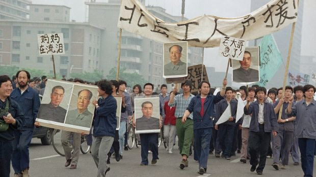 Pro-democracy demonstrators carry portraits of former Chinese rulers Mao Tse-Tung and Chou En-Lai as they march to join student strikers at Tiananmen Square in June 1989. Photograph: Sadayuki Mikami