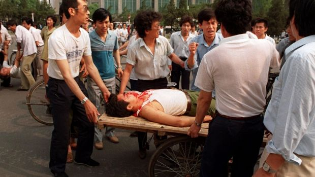 A wounded man on a rickshaw flatbed shortly after soldiers opened fire on a crowd in Beijing on June 4th, 1989. Photograph: Liu Heung Shing