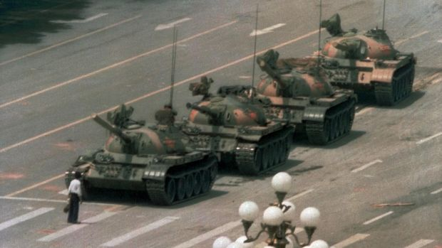 A Chinese man blocks a line of tanks heading east on Beijing's Changan Blvd on June 5th, 1989, after Chinese forces crushed a pro democracy demonstration in Tiananmen Square. Photograph: Jeff Widener