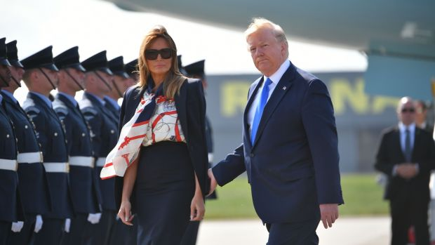 US president Donald Trump and US first lady Melania Trump walk on the tarmac after disembarking Air Force One at Stansted Airport on Monday. Photograph: Getty Images