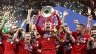 Liverpool's Jordan Henderson celebrates with the trophy and teammates after winning the Champions League final. Photograph: Carl Recine/Reuters