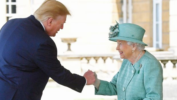 Queen Elizabeth greets Donald Trump as he arrives at Buckingham Palace. Photograph: Victoria Jones/PA Wire