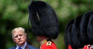US president Donald Trump inspects the guard of honour during a ceremonial welcome at Buckingham Palace. Photograph: Toby Melville/PA Wire