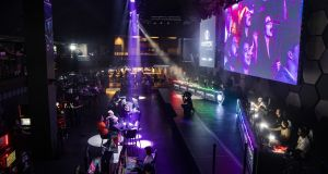 Competitors prepare to play Mario Kart during a Saturday Night Speedway tournament at the HyperX Esports Arena at the Luxor Hotel and Casino in Las Vegas. Photograph: Joe Buglewicz/New York Times