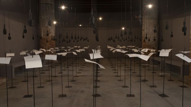 In Your Tongue I Cannot Fit by Shilpa Gupta, a sound installation with 100 speakers, microphones, printed text and metal stands. Photograph: Italo Rondinella, courtesy La Biennale di Venezia