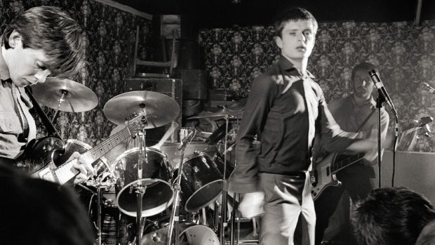 Bernard Sumner, Ian Curtis and Peter Hook of Joy Division performing live at Bowdon Vale Youth Club. Photograph: Martin O'Neill/Redferns