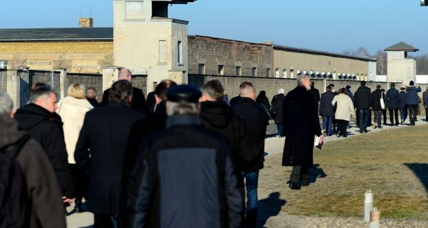Visitors at the  Sachsenhausen former Nazi concentration camp near Berlin. Christians were silent and colluded with systemic genocide by choosing not to know, even when knowing.  Photograph: Maurizio Gambarini/AFP/Getty Images