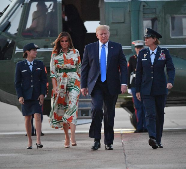 Style homage: for their flight to the UK Melania Trump wore a Gucci dress that featured Big Ben, the Houses of Parliament and double-decker buses. Photograph: Mandel Ngan/AFP/Getty