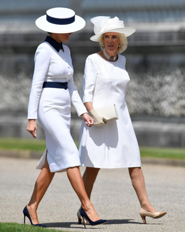 At Buckingham Palace with Camilla, duchess of Cornwall: Melania Trump's tailored white pencil dress with navy trim and boater hat were similar to a look Diana, princess of Wales, wore in Japan in 1986. Photograph: Toby Melville/WPA Pool/Getty