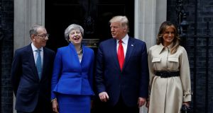 US President Donald Trump and First Lady Melania Trump meet Britain's Prime Minister Theresa May and her husband Philip at Downing Street. Photograph: Peter Nicholls/Reuters