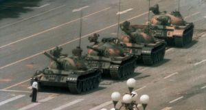 A Chinese man blocks a line of tanks heading east on Beijing's Changan Boulevard after Chinese forces crushed a pro-democracy demonstration in Tiananmen Square on June 5th, 1989. Photograph: Jeff Widener/AP Photo