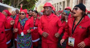 Members of the Economic Freedom Fighters with their leader Julius Malema. Photograph: Rodger Bosch/AFP/Getty