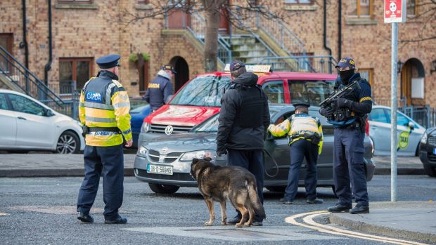 Armed gardaí with sniffer dogs at a major checkpoint on the corner of Bridgefoot Street and Oliver Bond Street in the south inner city on the eve of the funeral of David Byrne in 2016